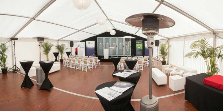 corporate marquee for hire with wooden floor and hetares