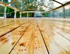 clear marquee with wooden floor for hire