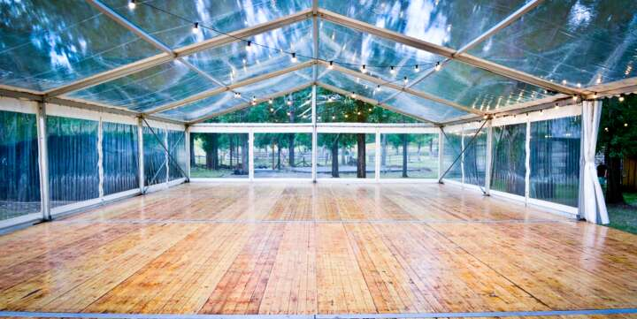 marquee with clear covers and wooden floor